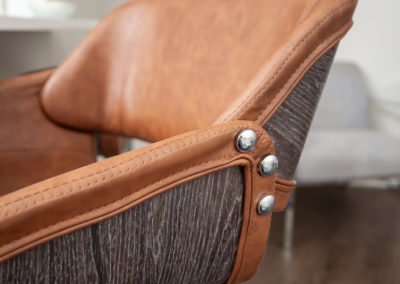 Close-up photo of details of a brown, leather chair