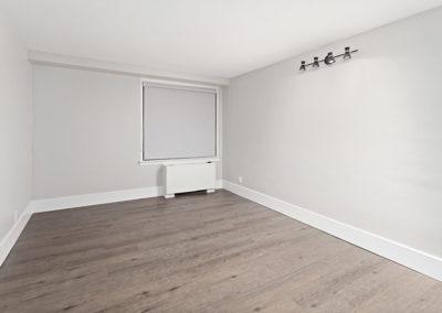 Open space floor plan with hardwood floors, contemporary lighting, and corner heating unit