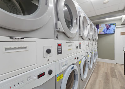 Apartment Laundry center with stacked washers and dryers
