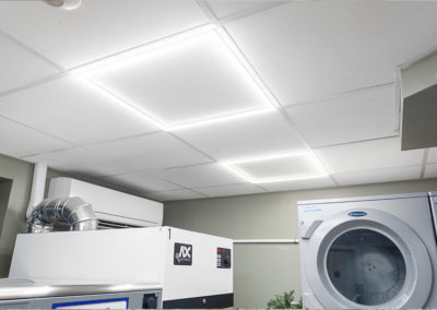 Ceiling lights in clean, laundry facilities at 2400 Hudson Apartments