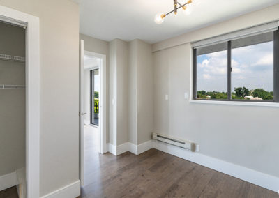 Bedroom with large closet and window at Fort Lee, NJ apartment for rent