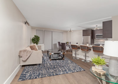 Open, contemporary floor plan showing living area and kitchen in apartment rental in Fort Lee, NJ