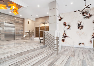 Modern, bright interior lobby at 2400 Hudson apartments in Fort Lee, NJ