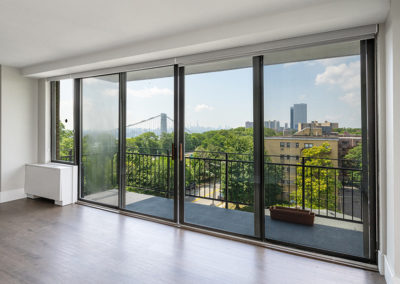 Beautiful, large sliding doors to balcony with view in Fort Lee apartment for rent
