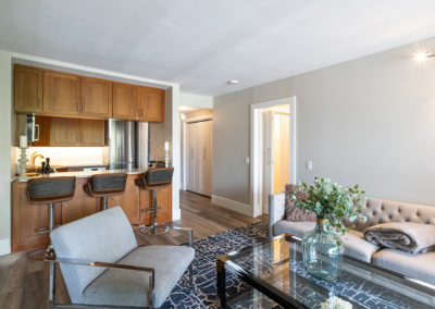 Modern living room with view into kitchen in 2-bedroom apartment near GW Bridge